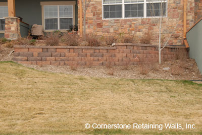 Landscape retaining wall built with Pavestone adobe modular block in Westminster, Colorado