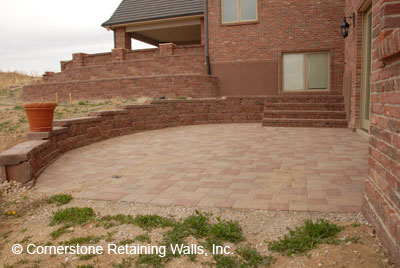 Italian Renaissance paver patio with Allan Block Abbey Blend sitting wall