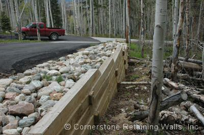 Timber retaining wall built to support the asphalt driveway