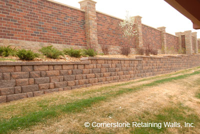 Structural retaining wall built with Pavestone Adobe Blend modular block